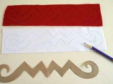 The traced template on red and white felt.
