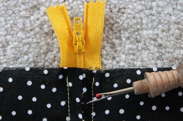 Use a seam ripper to remove the basting stitches.