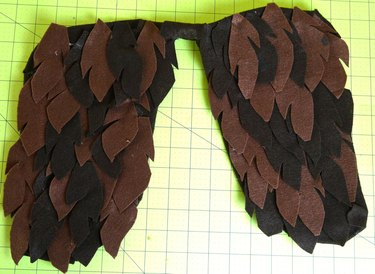 Completed wings covered in brown felt feathers.