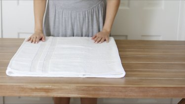 Folding towel over