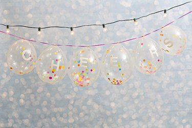 Hanging confetti-filled balloons