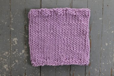 Finished knit cowl in stockinette stitch.