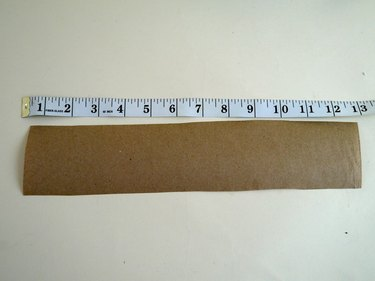 Strip of brown paper and a ruler.
