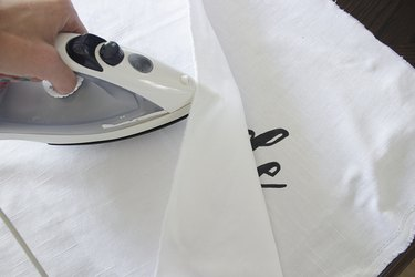 Ironing painting fabric.