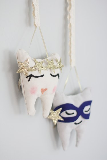 Two hanging tooth fairy pillows