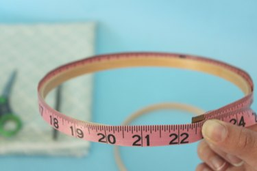 Measure the embroidery hoop with a measuring tape.