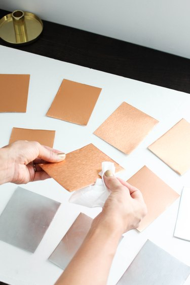 Wiping away smudges on metal frames with wet wipes