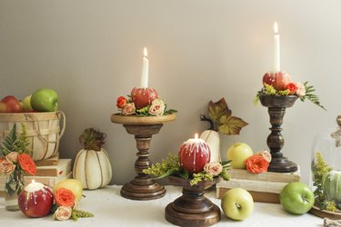 Apple Candles on wooden candle holderc