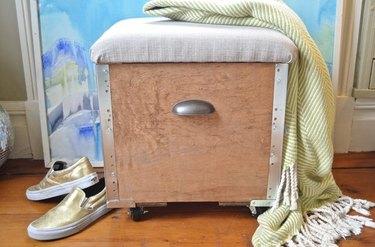Upholstered ottoman.