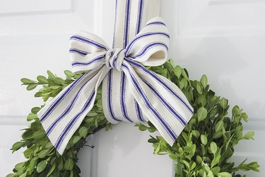 Bow attached on wreath.