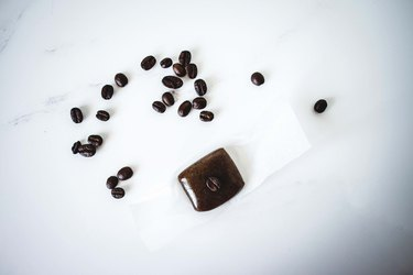 Coffee caramel on a piece of waxed parchment.