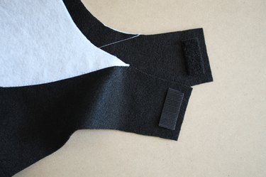 Sew hook-and-loop tape onto the chin straps to secure the hood.