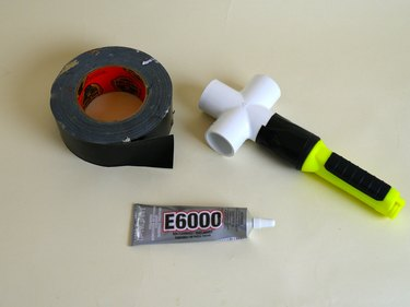 Attached flashlight and cross joint with epoxy and tape.