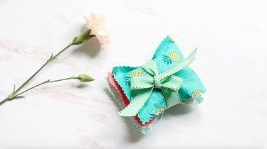 Three sachets tied with ribbon