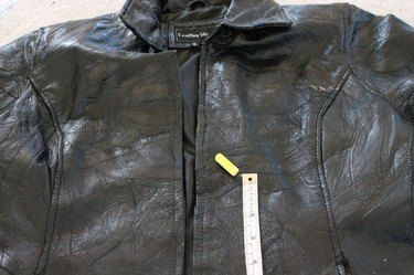 Measure and mark the bottom piece of the leather jacket.