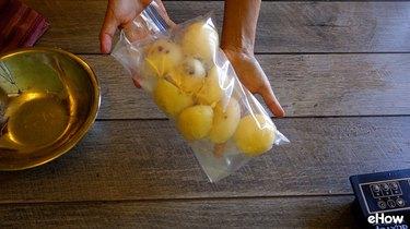 Freezing par-cooked potatoes in a freezer bag.