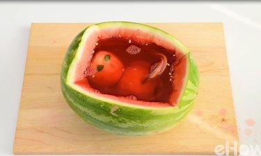 An alien baby in a watermelon womb.