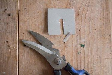 Cut slit in aluminum lid