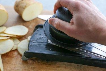 Potato slices and mandolin slicer