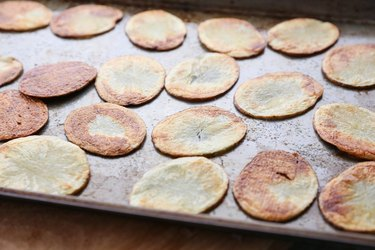 Baked chips on a baking sheet
