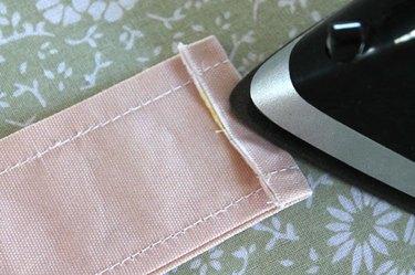 press under strap ends