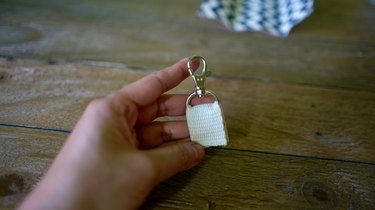 Cotton belting inserted into D-ring with lobster clasp