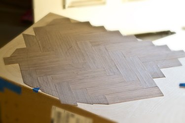 Redraw the letter on top of the veneer.