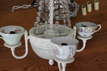 Place the teacups over the electrical sockets.
