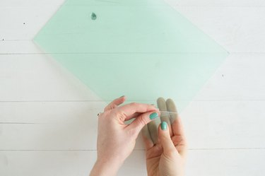 Peeling protective plastic from plexiglass