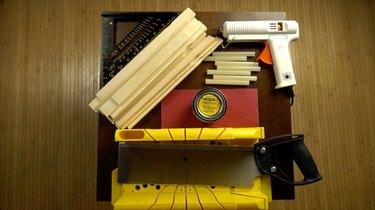 Materials for DIY herringbone pattern tabletop using paint sticks.