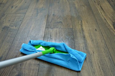 Mop floor with back and forth motion.