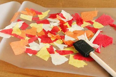 Torn tissue paper on self-laminating pouches