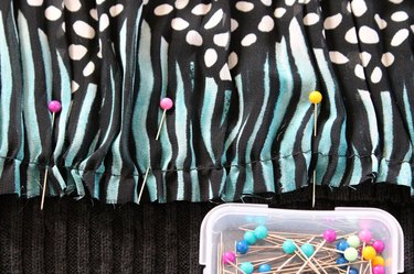 Gather the top of the fabric piece and pin to the sweater.