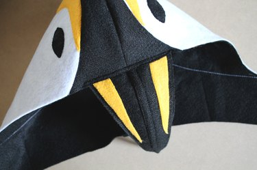 Adjust the beak until it's centered and sew it to the hood.