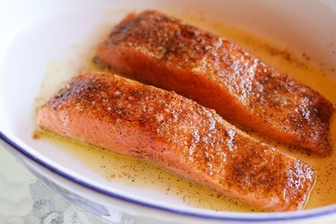 Raw salmon with oil and seasoning