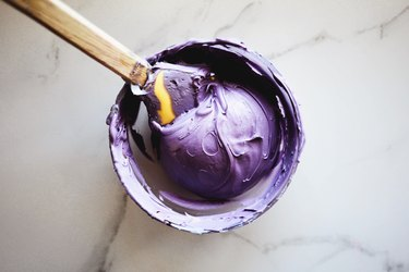 Mix the red and blue food colorings together to form a smooth shade of purple.