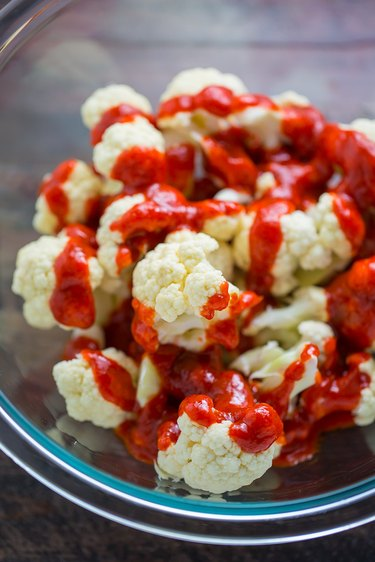 In a large bowl combine the cauliflower bites and buffalo sauce.