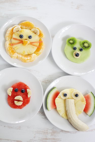 Four plated animal face fruit snacks for kids