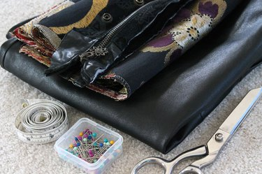 Materials needed to make a leather skirt bigger.
