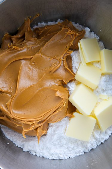 In a large bowl combine the peanut butter, sugar, butter, and vanilla.
