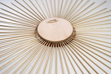 This sunburst mirror design is composed of 64 spokes