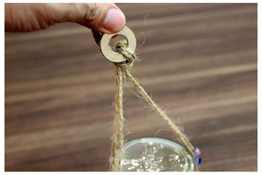 Tying string to metal washer.