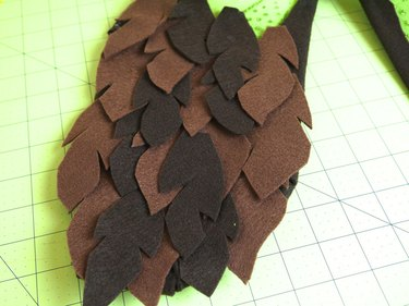Bottom half of wing covered in brown felt feathers.