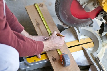 Measure and cut fence post pickets.