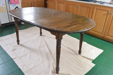 Cheap table with flaking finish