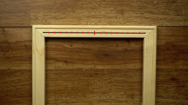 Measuring and marking canvas stretchers to make DIY simple frame loom.