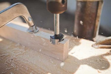 Cutting the cross braces with a Forstner