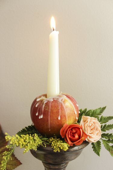 Taper apple candle with flowers.