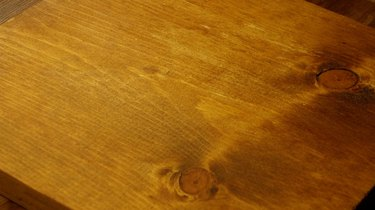 Pine board stained with instant coffee.