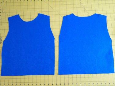 Two vest shaped pieces of blue felt.